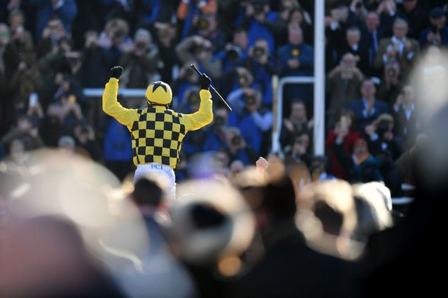 Paul Townend riding Al Boum Photo celebrates winning the Gold Cup in front of spectators at Cheltenham Racecourse on 13 March 2020. (Pic: Getty Images)