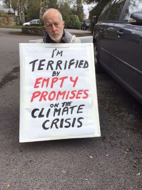 Dr Bing Jones with his sign that he will use in the protest.