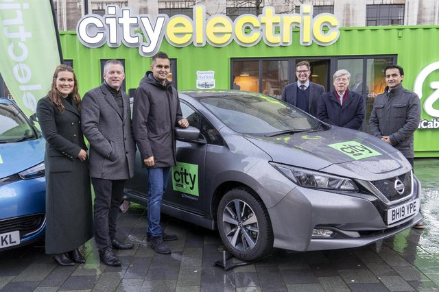 Launch of the City Taxis goes electric plan in December.From left: Sinead Gillett and Gavan Walsh of icabbi, Arnie Singh and Davud Aryan of City Taxis, Mick Tope icabbi and Neil Davies RCI bank and services. Picture Scott Merrylees
