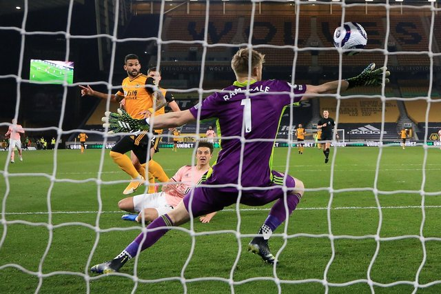 Wolverhampton Wanderers' Brazilian striker Willian José (centre left) scores the opening goal of the English Premier League football match between Wolverhampton Wanderers and Sheffield United at the Molineux stadium in Wolverhampton, central England on April 17, 2021. (Photo by Catherine Ivill / POOL / AFP) / RESTRICTED TO EDITORIAL USE. No use with unauthorized audio, video, data, fixture lists, club/league logos or 'live' services. Online in-match use limited to 120 images. An additional 40 images may be used in extra time. No video emulation. Social media in-match use limited to 120 images. An additional 40 images may be used in extra time. No use in betting publications, games or single club/league/player publications. /  (Photo by CATHERINE IVILL/POOL/AFP via Getty Images)