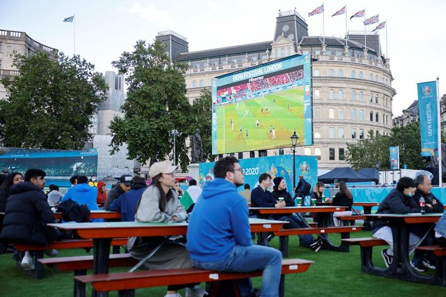 Football fans watch the UEFA EURO 2020 semi-final football match between Spain and Italy, at the FanZone in Trafalgar Square, central London on July 6, 2021. (Photo by Tolga Akmen / AFP) (Photo by TOLGA AKMEN/AFP via Getty Images)