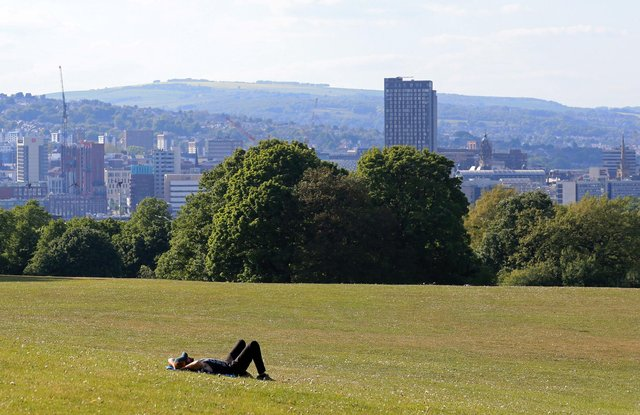 A man lays on the grass to enjoy the sunshine in Norton park in Sheffield  (Photo by Lindsey Parnaby / AFP) (Photo by LINDSEY PARNABY/AFP via Getty Images)