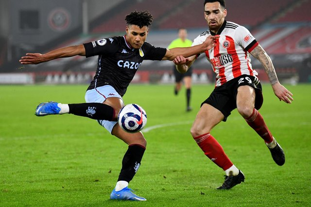 Aston Villa's Ollie Watkins (left) and Sheffield United's Kean Bryan battle for the ball: Clive Mason/PA Wire.