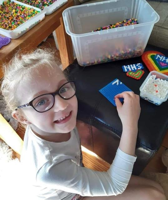 Imogen while busy creating some of the hama bead figures to help raise money for Captain Moore.