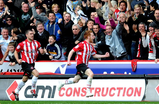 Stephen Quinn celebrates his opening goal infont of the Blades fans. Picture: Jonathan Gawthorpe.