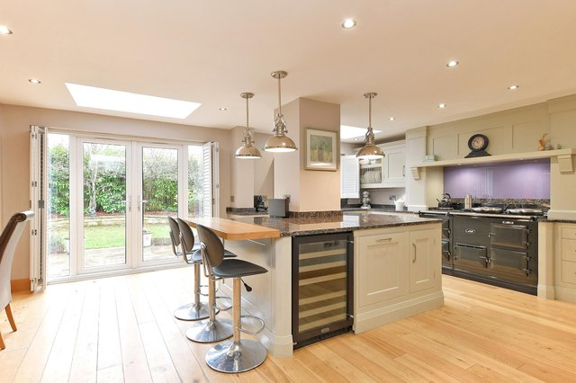 The dining kitchen is packed with features including granite work surfaces, a Franke Belfast style sink, a central island, providing further storage with a matching granite work surface and an oak work surface extends to allow breakfast seating for three chairs. Appliances include an integrated Siemens dishwasher and a Rangemaster wine cooler.