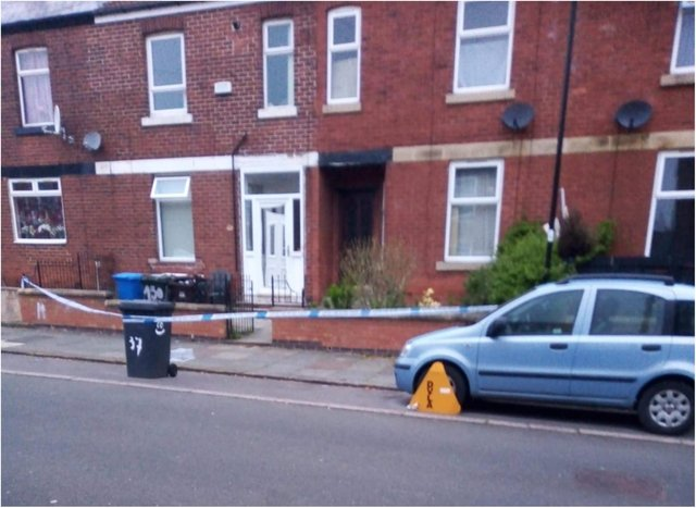 Two homes on Kirton Road, Pitsmoor, are taped off by the police this morning