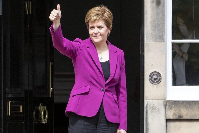Scottish First Minister and SNP leader Nicola Sturgeon on the steps outside Bute House in Edinburgh. Photo: Jane Barlow/PA Wire