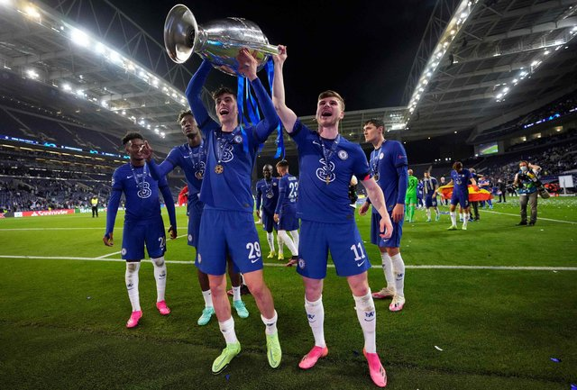 Chelsea's German midfielder Kai Havertz (L front) and Chelsea's German forward Timo Werner (R front) hold the Champions League trophy as they celebrate after winning the UEFA Champions League final football match between Manchester City and Chelsea at the Dragao stadium in Porto on May 29, 2021. (Photo by Manu Fernandez / POOL / AFP) (Photo by MANU FERNANDEZ/POOL/AFP via Getty Images)