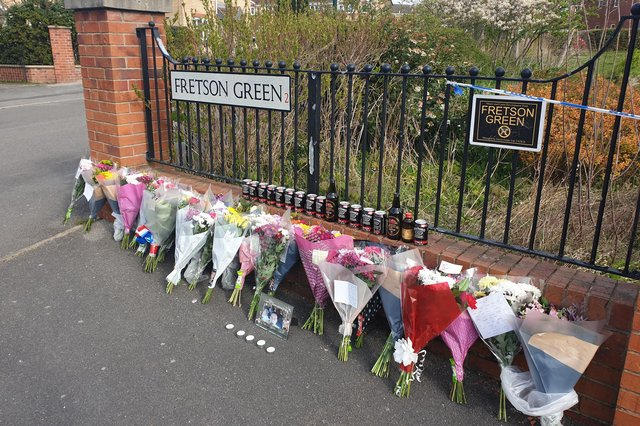 Flowers have been left close to the spot where a man was killed on the Manor estate in Sheffield yesterday