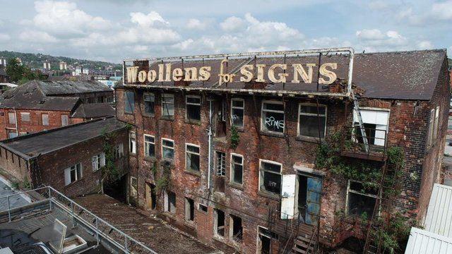 The Woollens sign is a well-known landmark.