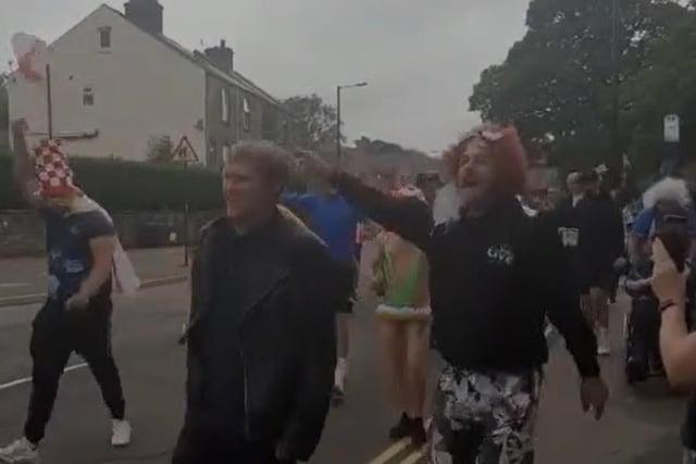 England fans march through Stocksbridge singing Vindaloo.