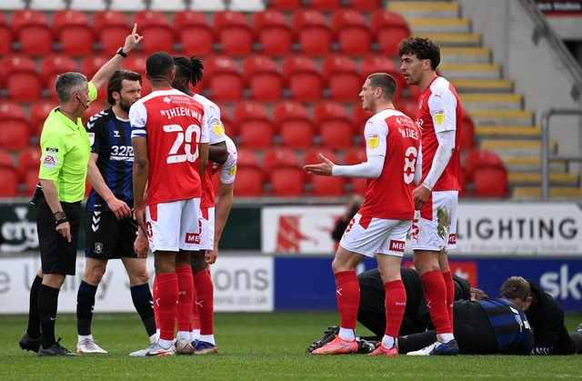 Referee Darren Bond instructs Matt Crooks of Rotherham United (R) to leave the field after being sent off during the Sky Bet Championship match between Rotherham United and Middlesbrough at AESSEAL New York Stadium.  (Photo by Ross Kinnaird/Getty Images)
