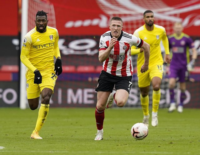 John Lundstram of Sheffield Utd  makes a break during the Premier League match at Bramall Lane, Sheffield. Picture date: 18th October 2020. Picture credit should read: Andrew Yates/Sportimage