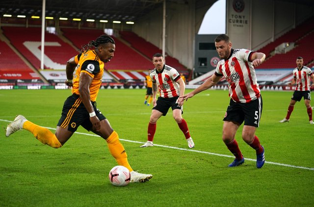 Adama Traore of Wolverhampton Wanderers is put under pressure by Jack O'Connell of Sheffield United.
