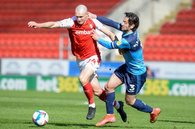 Rotherham's Michael Smith gets away from a grappling Joe Jacobson