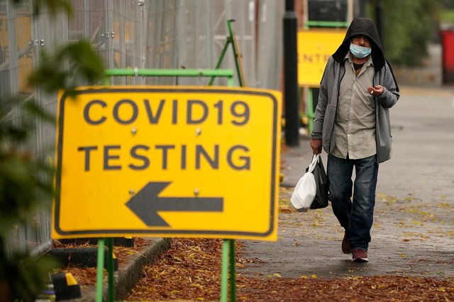 A man walks past a Covid-19 testing site  (Photo by Christopher Furlong/Getty Images)