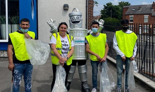 Phil the Bin with volunteers on a litter pick
