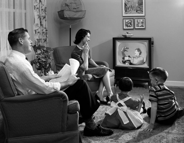 A family watching telly in the 1950s
