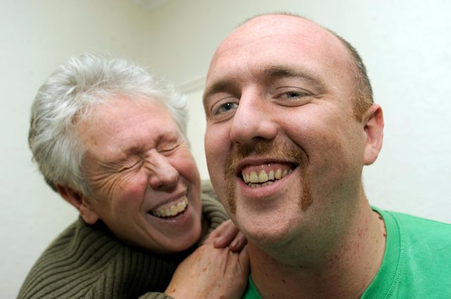 Pictured is James Raistrick of Robin Lane, Beighton,who took part in Movember in 2011 to raise cash for the palliative care ward in Sheffield in memory of his Dad Andy a former City policeman who died. Pictured with James his is Mum Sue
