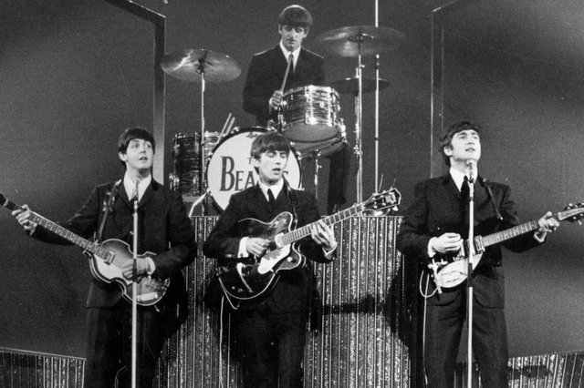 The Beatles on stage at the London Palladium. (Photo by Michael Webb/Getty Images)