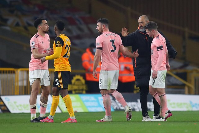 Nelson Semedo and Nuno Espirito Santo, manager of Wolverhampton Wanderers, console Kean Bryan, Enda Stevens and Oliver Norwood of Sheffield United after defeat confirmed Sheffield United's relegation from Premier League (Photo by Catherine Ivill/Getty Images)