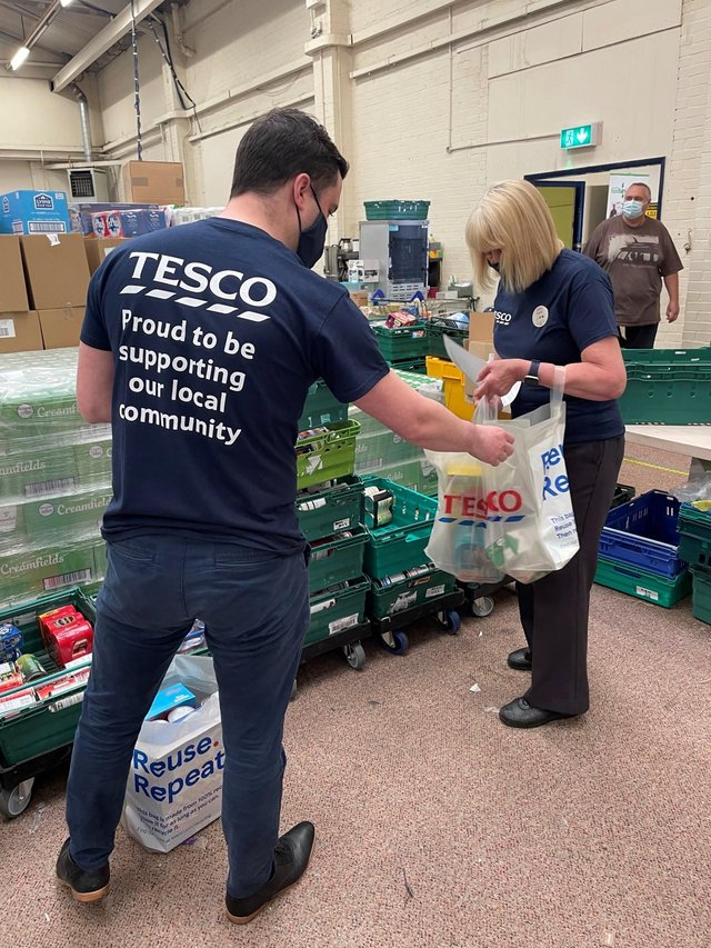 Volunteers from Tesco give their time to help out at the S6 Food Bank.