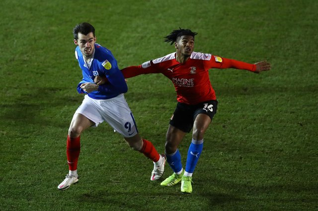Swindon Town defender Akin Odimayo has been linked with a move to Sheffield Wednesday.