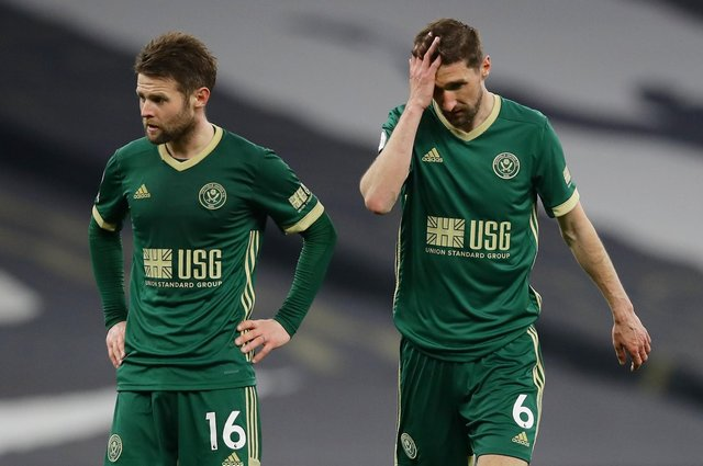 Oliver Norwood and Chris Basham react after Sheffield United's defeat at Spurs: David Klein / Sportimage