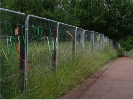 Residents have tied ribbons and messages on fencing erected by developers at Owlthorpe Fields Crystal Peaks