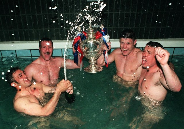 Whetu Taewa, Paul Broadbent, Mark Aston and Paul Carr celebrate the Challenge Cup victory in the famous Wembley bath. Photo: Paul Chappells