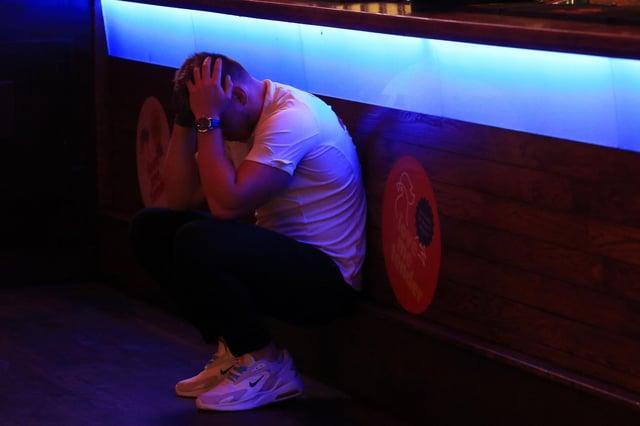 An England fan in The Common Room following the penalty shootout heartbreak.
