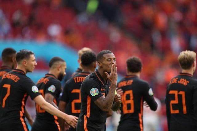 Netherlands' midfielder Georginio Wijnaldum celebrates scoring against North Macedonia. Photo by KENZO TRIBOUILLARD/POOL/AFP via Getty Images