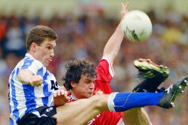 Former Sheffield Wednesday captain Nigel Pearson challenges Mark Hughes of Manchester United during the 1991 League Cup Final.