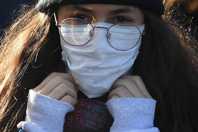 A woman wears a protective face mask in London.  (Photo: Getty).