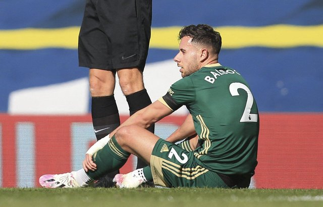 Sheffield United's English defender George Baldock sits on the pitch after taking a knock in a challenge during the English Premier League football match between Leeds United and Sheffield United at Elland Road: LINDSEY PARNABY/POOL/AFP via Getty Images