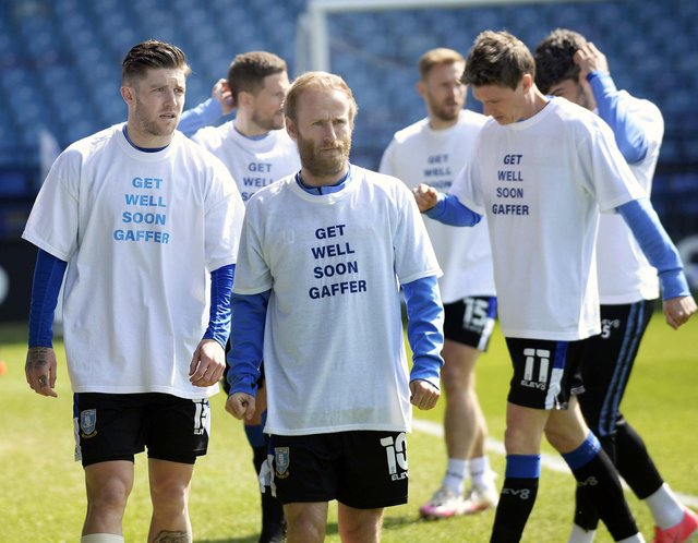 Sheffield Wednesday players with messages of support on their warm-up shirts for manager, Darren Moore, in hospital with Covid. (Pic Steve Ellis)