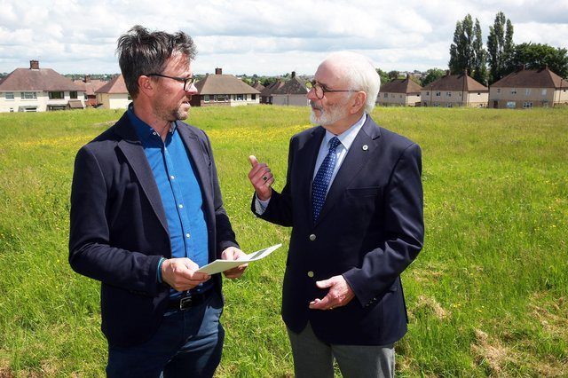 Steve Birch from Sheffield Housing Company and Coun Tony Damms discuss the forthcoming Malthouses project as well as the information leaflets that will be given to local residents in Parson Cross. Photo by Glenn Ashley.