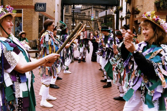 Female Morris dancers performing in Orchard Square during Environment Week, July 1996. Ref no: s29029