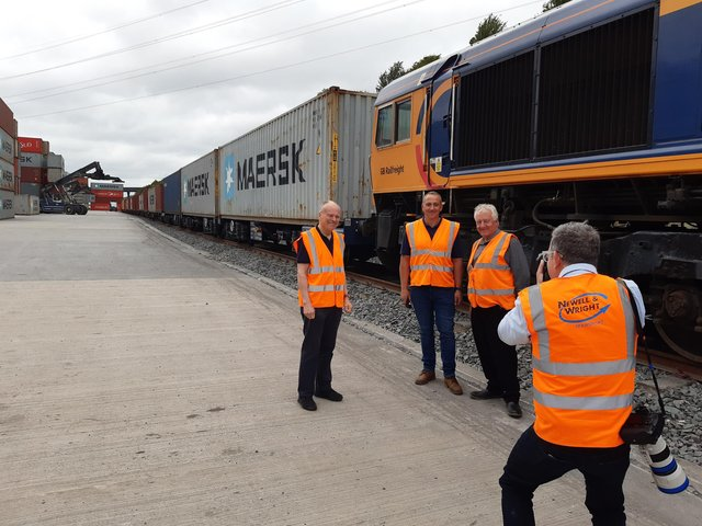 From left: MP Clive Betts and Stephen and Frank Newell have their picture taken as a train arrives.