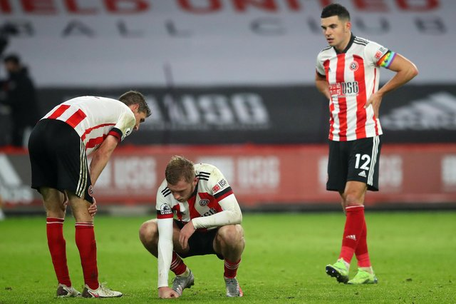 Dejected Sheffield United trio Chris Basham, Oli McBurnie and John Egan at the final whistle following the Blades' 2-1 defeat to Leicester City at Bramall Lane yesterday. Photo: Simon Bellis/Sportimage