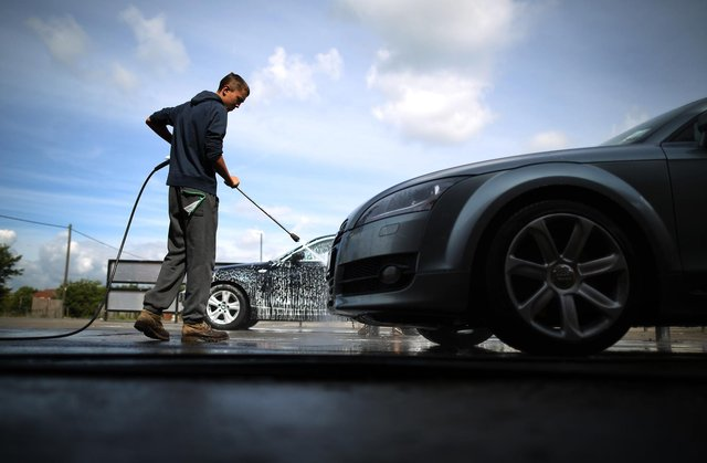 Man washes car  (Photo by Peter Macdiarmid/Getty Images)