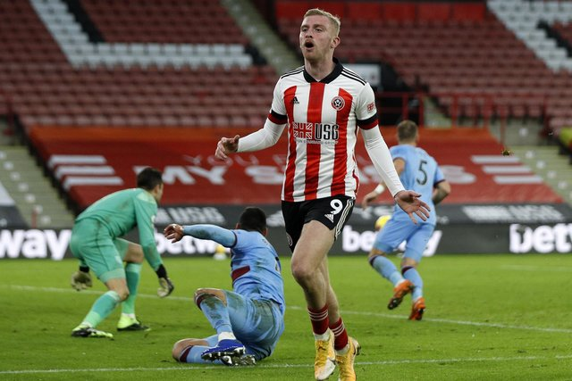 Sheffield United's Oliver McBurnie looks on dejected after missing a chance against West Ham: Darren Staples/Sportimage