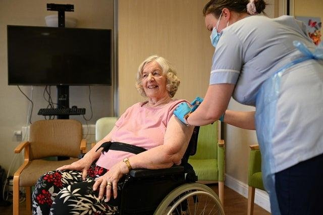 Patient receives her vaccination for Covid-19
