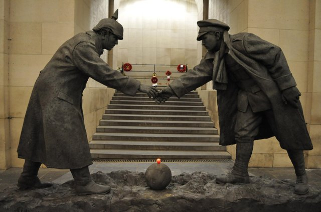 Andy Edwards' truce statue All Together Now at the Menin Gate British war memorial in Ypres, Belgium