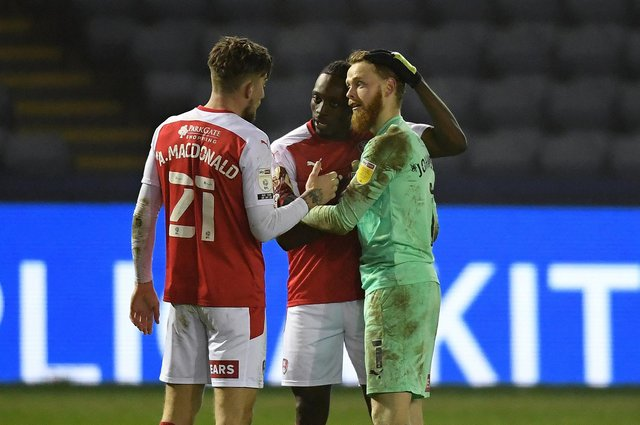 Angus MacDonald, Freddie Ladapo and Viktor Johansson of Rotherham United  celebrate after the Sky Bet Championship match between Sheffield Wednesday and Rotherham United at Hillsborough  (Photo by Ross Kinnaird/Getty Images)