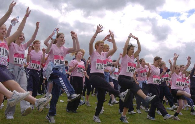 A pre-run warm-up session for the Race for Life at Don Valley Bowl in May 2005