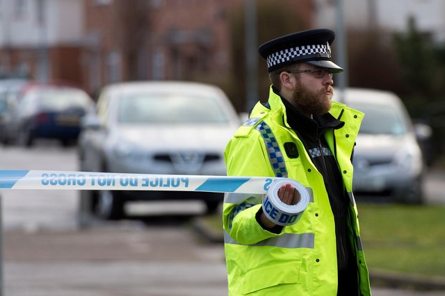 A police officer puts up a cordon  (Photo by Matthew Horwood/Getty Images)