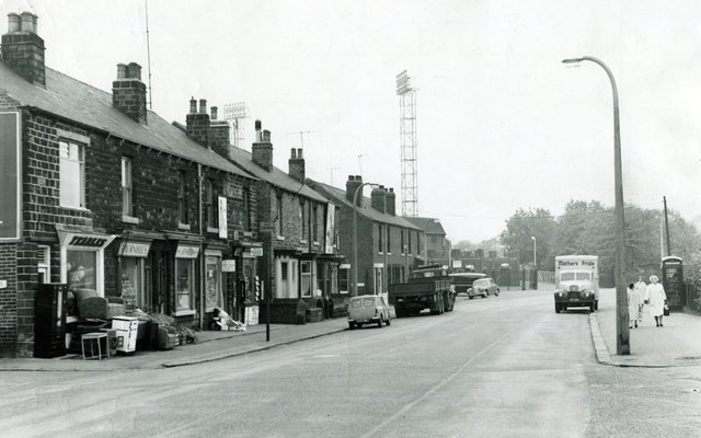 Leppings Lane, Hillsborough, in 1963 with the Sheffield Wednesday floodlights towering over the terraced houses and shops.