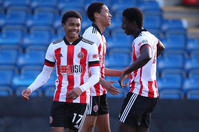 Daniel Jebbison, centre, celebrates a goal with Antwoine Hackford, left: Simon Bellis/Sportimage